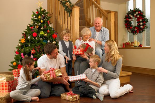 happy-family-and-grandparents-handing-out-presents-on-christmas-day